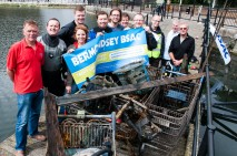 Members of 'Bermondsey BSAC 42' with shopping trolleys and other rubbish collected from the bottom of Canada Water whilst taking part in the BSAC (British Sub Aqua Club) Underwater Litter Pick 2012 which is highlighting the problem of litter in Britain's seas and waterways and the threat it poses to marine life.